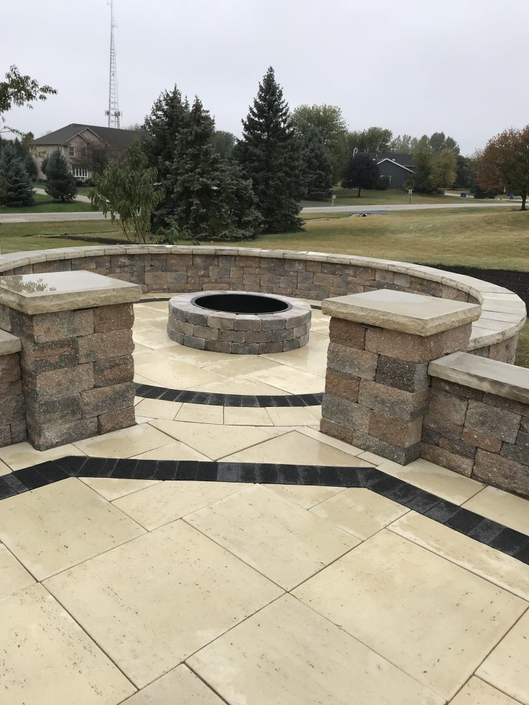 Tan and black brick Fire pit and patio design project