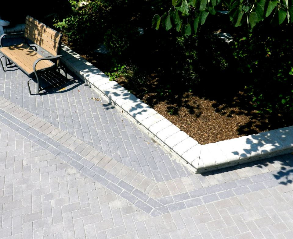 Tone on tone gray brick paved driveway design project. Design Build landscaping services.